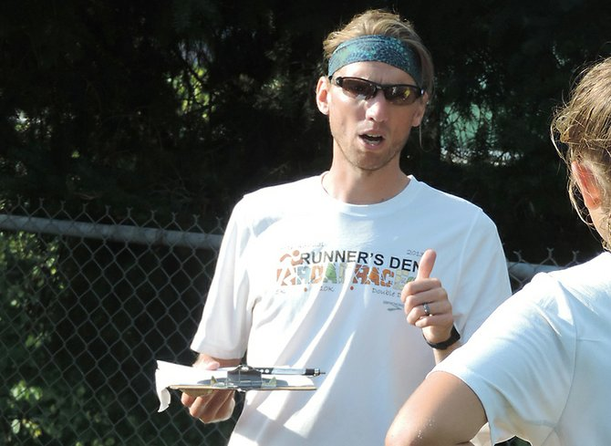 New coach: Brandon Bertram takes over for Kristen Uhler this fall as HRVHS's head cross country coach. He is pictured here talking with a runner during last week's Blue and Gold night at HRV.