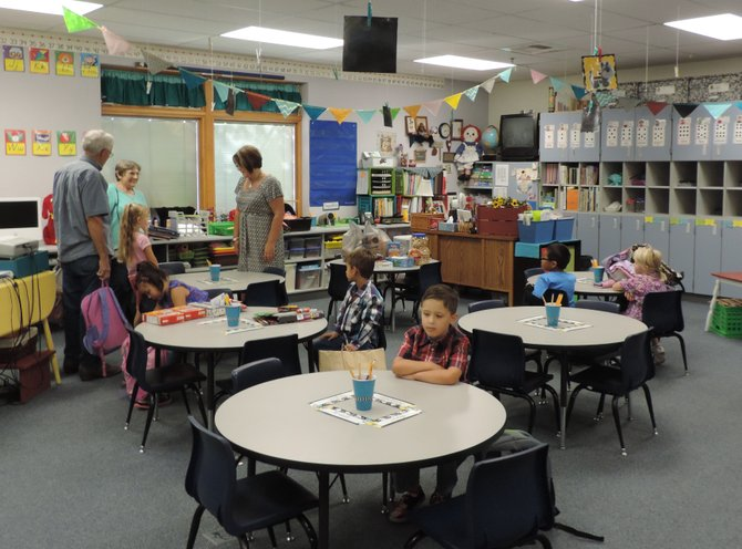 Students take a seat in Mrs. Donna Weitman's first-grade classroom at Tonasket Elementary, Wednesday morning.