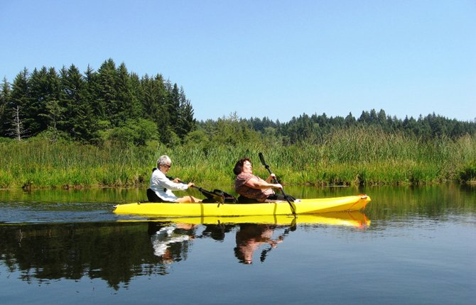 JANET TSCHANZ gives her sister, Lilli Johnson, her first kayak ride along Beaver Creek.