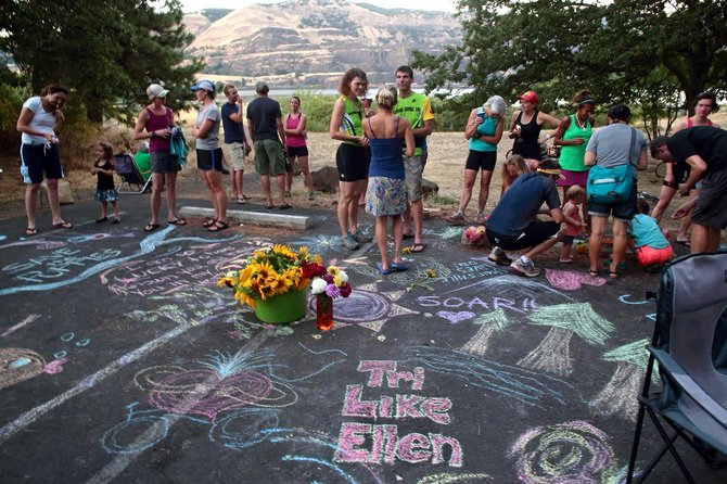 'Tri like Ellen' reads a colorful chalk memorial drawn in EllenDittebrandt's memory Tuesday evening during the Columbia Gorge Tri Club's weekly workout.  Dittebrandt was an enthusiastic new  member of the group before she was killed  last Sunday.