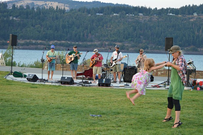 Anya Patton, of Hood River, and daughter Siva, 5, dance to Cripple Hop's encore cover of Jimi Hendrix's Voodoo Child Sunday at Waterfront Park. A large crowd gathered for the dual performances of Toy Gun Conspiracy and Cripple Hop at the first-ever Hood River Waterfront Park Celebration.