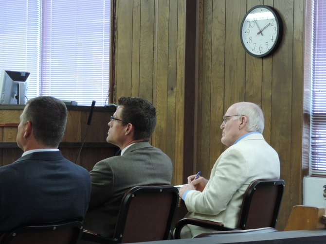 Don Moore, right, and public defender Michael Prince, center, in Okanogan County Superior Court on Thursday afternoon.