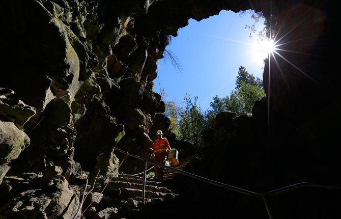 Clint Thostenson, with Catworks Construction, carries sonotubes down the stairs to prepare for some concrete pouring during work in the Lava River Cave near Bend Thursday, Sept. 11. Work will continue in the cave through next month and include railing, stair, and walkway replacement. The Cave closed for the season Sept. 8.