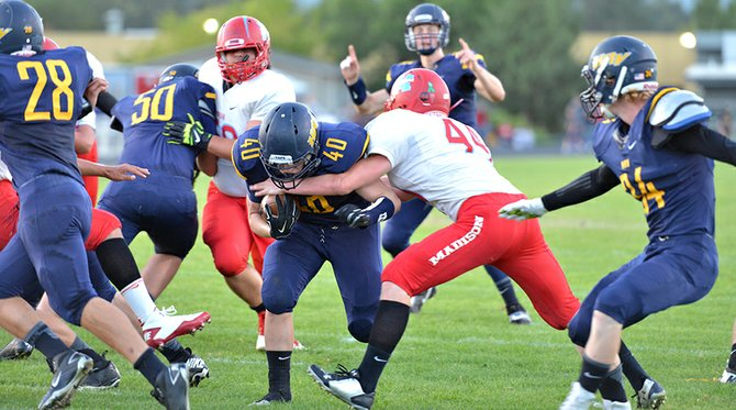 hammer time: HRV football players in action Friday night in the Eagles' commanding home-opener win against Madison.