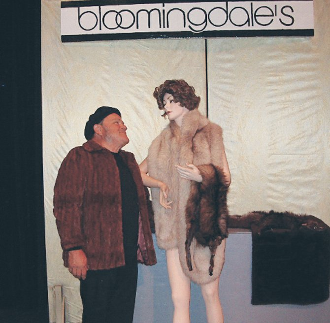 Tom Stegeman, who drew the role of an ex-con named Harry, rehearses his lines for the play 70, Girls, 70. Here, Harry takes a break to admire a mannequin during a heistof expensive furs at Bloomingdales.