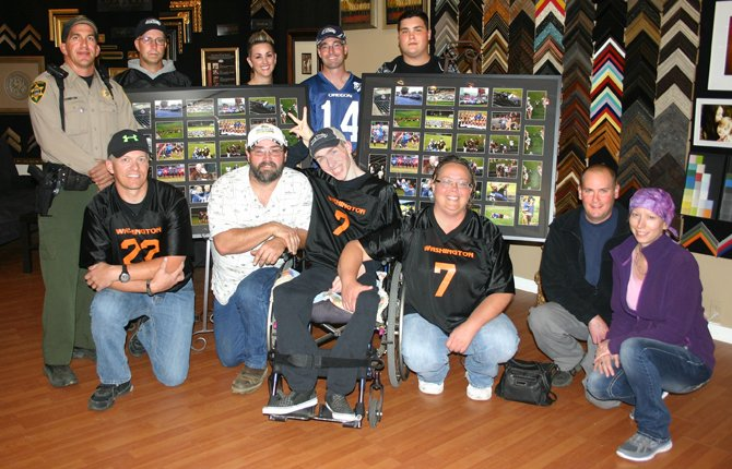 PIG BOWL participants and administrators come together for a check ceremony at Westwind Frame and Gallery on 2nd Street in The Dalles Wednesday. In the front row are (pictured from left to right), Randy Wells, Ric Miner, Josh Miner, Angie Robinson, Derek Martin and Misty Martin. In the back row are (from left), Ed Gunnyon, Stan Berkshire, Marty Hiser, Michael Holloran and Jeremiah Miner. Through generous donations, more than $25,000 was raised in the 12th annual Pig Bowl event.