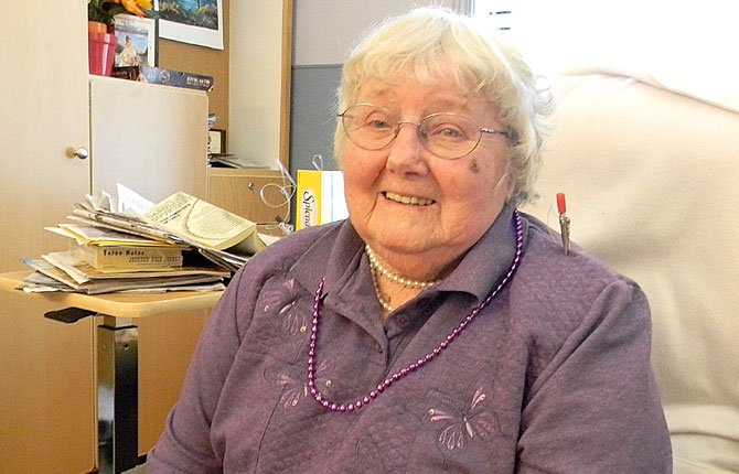 LAURA ASHBRENNER smiles from her favorite chair at Columbia Basin Care Facility in The Dalles on Oct. 2, just a day away from her 100th birthday. She is an artist who has dedicated much of her life to capturing the beauty of the gorge in her paintings. She worked at The Dalles Art Center for years, as well as other galleries. She was married 75 years and said God was good in matching her with her late husband.