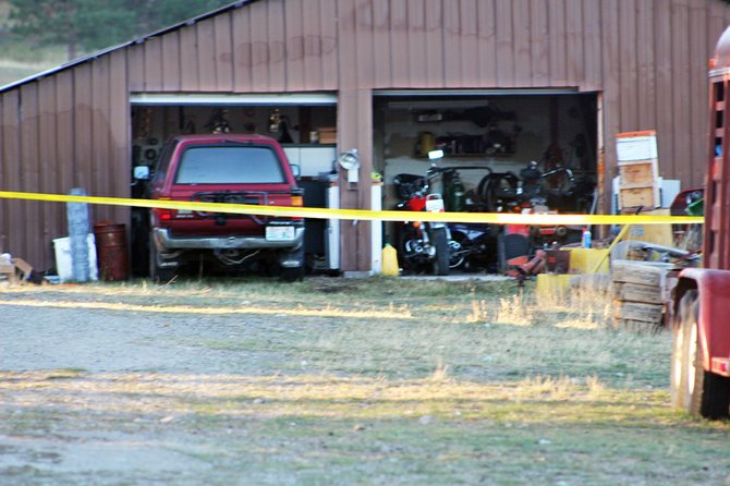 Yellow crime scene tape hangs across the entry to the garage of 39-year-old Patrick M. Alltus, the victim of an apparent homicide, at his 151 Hosheit Road home in Tunk Valley.