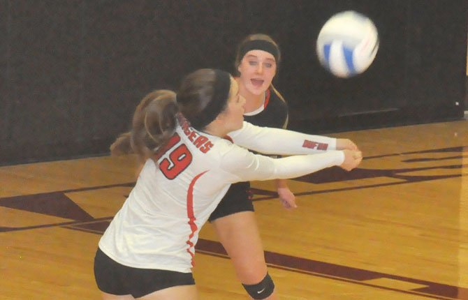 DUFUR libero Abbey Stelzer (front) returns a volley while teammate Tianna Ellis directs traffic in the first set of Thursday's 1A volleyball match in Ione. The No. 1 Rangers cruised to a three-game sweep.