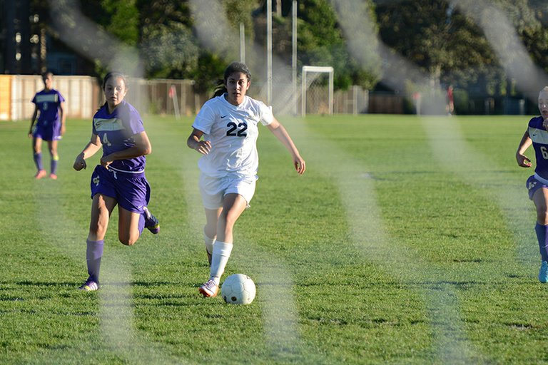 En route to victory, Hood River Valley High School varsity soccer players Sindy Magana and Joel Garcia are pictured in action Tuesday against Hermiston. The HRV girls hosted the Bulldogs and won 2-0 while the boys went on the road and came away with a 5-0 victory. Next week the Eagles take on The Dalles, on Tuesday, with the boys home (4 p.m. at Westside school) and the girls on the road.