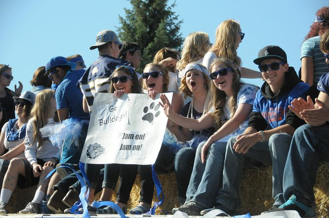 The junior class shows its spirit on their float.
