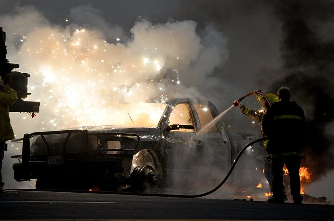 Multiple times, a shower of sparks erupted from the burning pickup as firefighters attempted to extinguish the vehicle fire last Thursday, Oct. 9, on the White Bird Grade on U.S. Highway 95. No injuries were reported.