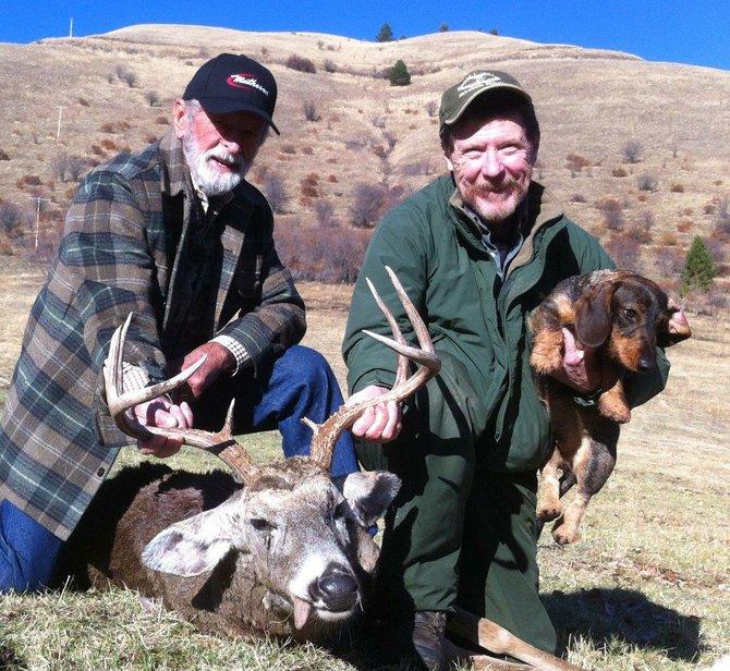 Edd Woslum, right, tracking dog Chui and hunter Brownie Matheson, whose deer Chui found.