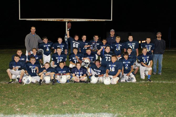 The Grangeville fifth- and sixth-graders won the Clearwater Youth Football League title, defeating Orofino in the championship game. The team finished with an 8-1 overall record. Pictured are (from left): front row, Ryan Cuthbert, Quincy Daniels, Ashton Beeson, Trid Charley, Levi Stowell, Jake Wren, Chase Young, and Dylan Placzek; middle row, Sebastian Darwish, Miles Lefebvre, Nelson Bruzas, Dayne Kinsley, Isaac Dewey, Jacob Hickmann, Jared Lindsley, and Kaylee Page; back row, coach Mac Lefebvre, Reece Wimer, Caleb Frei, Dane Lindsley, Blake Schoo, Jaret McFrederick, Emilio Barela, coach Nolan Schoo, Isaac VanDomelen, Jeffery Hickmann, Matt Blackmer, and coach Jonico Charley. Not pictured are Tori Ebert, Jackson Page, Jordan Clark, and coach Brad Mundt.