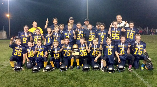 League champs:Hood River's 5th/6th grade team poses after winning the league championship last weekend.Pictured are (front, left to right) Gus Simonds, Trey Olmstead, Taylor Routson, Jack Wilson, Trenton Hughes, Preston Armstrong, Weston Sierverkropp, Joey Frazier, Ian Searcy, Robert Rowan, (middle row, left to right) Tanner Fletcher, Joshua Franz, Thys Van Bysteren, Eli Phelps, Michael Goodman, Sebastian Zeman, Emilio Casteneda, Joseph Kahler, Henry Buckles, Spencer Erspamer, Alex Whitaker, Carlos Najera and (back row) coaches Vinny Wilson, Mike Zeman, Justin Frazier, Jerome Kahler and Pete Hughes.
