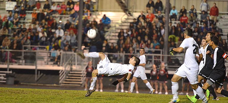 Alex Gutierrez hits a bicycle kick in the first half. Although he didn't score on this play, Gutierrez found the net twice to help the team to the win.