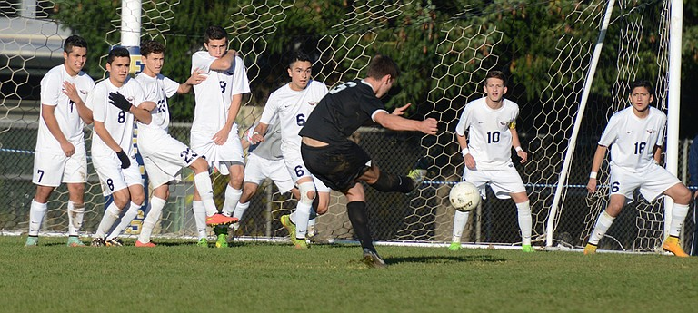 HRV players defend a Mountain View shot attempt during the Eagles' 7-1 win over the Cougars in the state quarterfinals, Nov. 8, 2014.