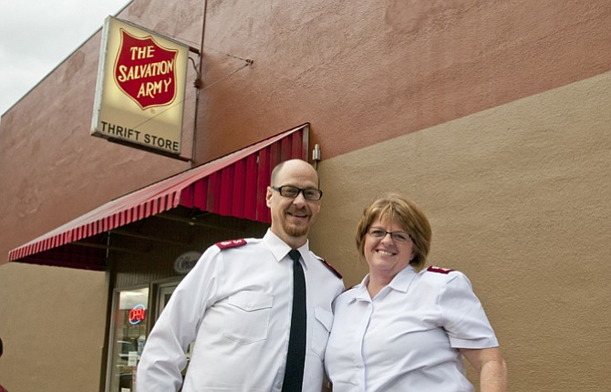 SALVATION ARMY Majors Kevin and Tammy Ray stand out front of the Salvation Army downtown thrift store and service center in The Dalles. The organization will celebrate 125 years of service in The Dalles Saturday, Nov. 15, with a celebration in the parking lot.