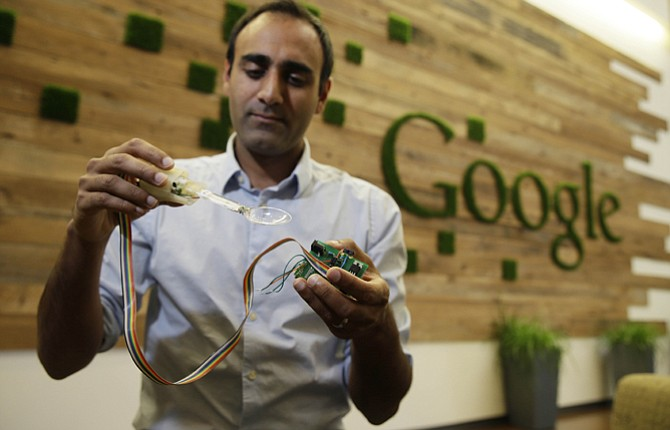 ANUPAM PATHAK, a senior hardware engineer at Google, shows off the prototype of the Liftware Spoon he developed that helps people eat without spilling in Mountain View, Calif. Just in time for the holidays, Google is throwing it's money, brain power and technology at the humble spoon. Not surprisingly, the company that has brought the driverless car and Internet glasses is bringing a unique improvement to the utensils. Built with hundreds of algorithms, these specially designed spoons make it much easier for people with tremors and Parkinson's Disease to eat without spilling. The spoons sense a shaking hand and make instant adjustments to stay balanced.