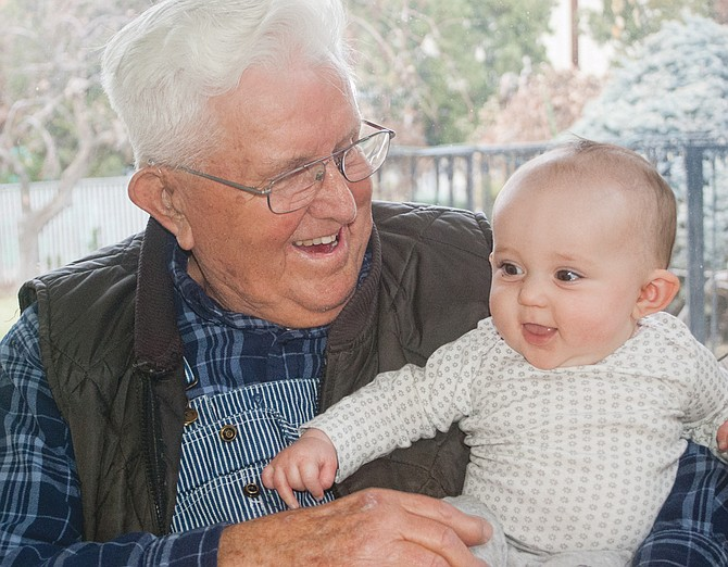 Outlook farmer Marvin Partch enjoys spending time with his grandchildren, which include this happy great-granddaughter, six-month-old Harlo Ingvalson of Prosser.