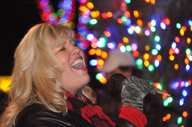 Colored lights, music and a visit from Santa Claus on the GVFDChristmas Truck kicked off the holiday season Saturday night, Nov. 29, at the Winter Magic tree lighting event in Grangeville's Pioneer Park. The annual event is sponsored by the Grangeville Horizons Recreation Committee with lighting funded through individual and business donations. A large crowd attended the event to hear performances, which included (pictured) Mellisa Gates.