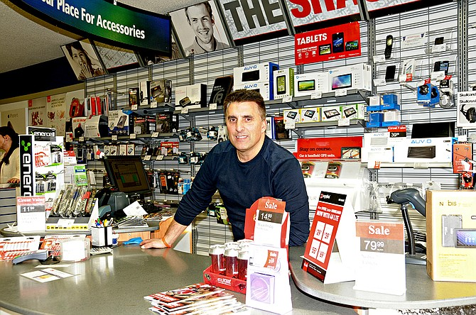 Robert Nida is shown here in his MainStreet store., One Hour Photo/RadioShack/Verizon. His wife, Linda, works full time for Pacific Cabinets in Ferdinand.