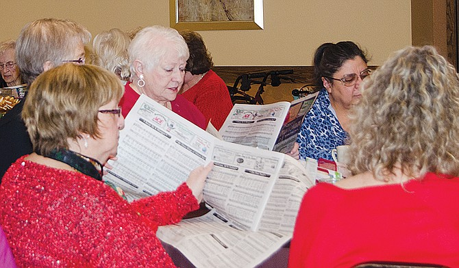 Singing Christmas carols at this past Tuesday's Christian Women's Connection meeting in Prosser are Alix Carlson, Ardith Carrat, Rollie Garner, Martha Martinez and Lorri Gilmur-Dillman (clockwise from left).