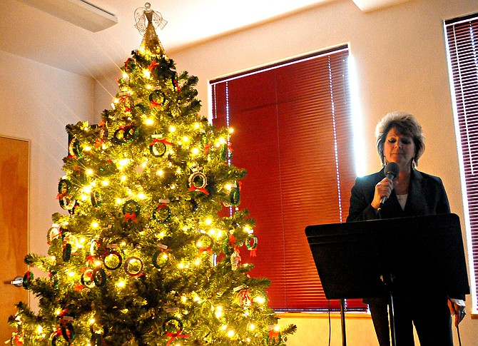 Wendy Lindsley sings at the Hospice Tree of Lights program.