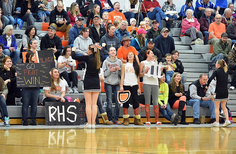 Fans cheer during Curlew at Republic basketball games Tuesday night.