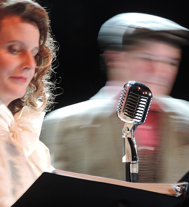 """ACTION IN the radio play """"It's A Wonderful Life"""" swirls around 1940s microphones; tune in Christmas Day on Radio Tierra and imagine the classic story unfolding."""
