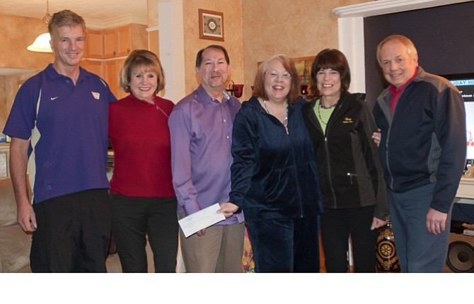 THE JOY of giving made Christmas this year a happier time for John Marvin-Kite and Diana Gale, center, and Bill Osborne and Cheryl Graham, left, who nominated them to be honored with a gift from Franz Bakery. Pictured are, left to right, Bill Osborne, Cheryl Osborne, John Marvin-Kite, Diana Gale, Jerri Schwartzel, manager of The Dalles Franz bread outlet store and Dave Long, Franz Bakery sales supervisor.