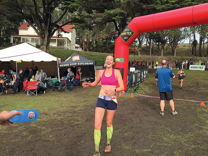 pure joy as Jax Mariash-Koudele crosses the finish line of a recent 50-mile endurance race.