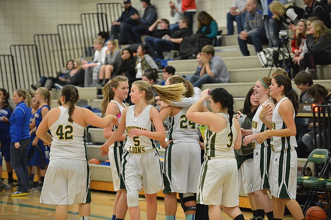 Liberty Bell girls celebrate its one-point victory over Tonasket on Tuesday.