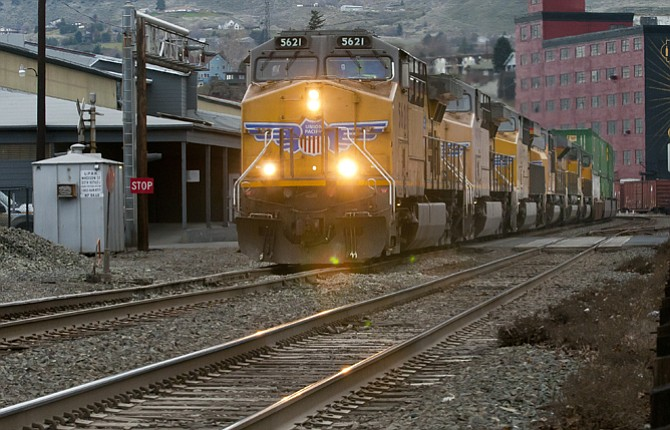 A UNION Pacific freight train runs west along First Street, downtown The Dalles. The City of The Dalles has joined other Oregon and Washington cities in requesting greater federal oversight of oil train transports.