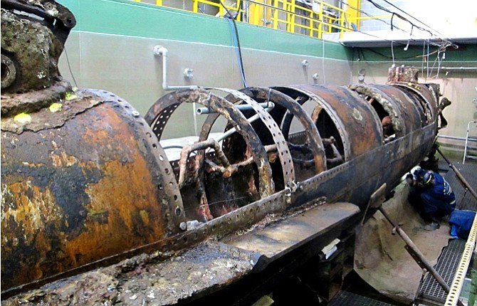 WORK IS underway in a South Carolina lab to remove encrustation from the hull of the Confederate submarine H.L. Hunley. Scientists say that after six months of work, about 70 percent of the encrusted sand, silt and rust from the outside of the first submarine in history to sink an enemy warship has been removed. Scientists hope that when the entire hull is revealed, it will provide the clues as to why the Hunley sank after sinking a Union blockade ship off Charleston, S.C., in 1864.