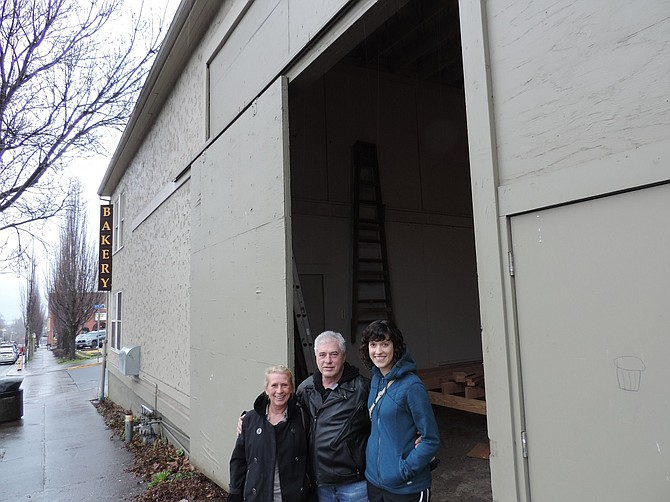 LOGSDON owner David Logsdon stands in the entry of the Logsdon Barrelhouse and Taproom, 505 Cascade, with his wife, Judith Bams, and his daughter, Tamara. The barrelhouse, located around the corner from Knead Bakery, will be open for Zwickelmania weekend, Feb. 14-15.