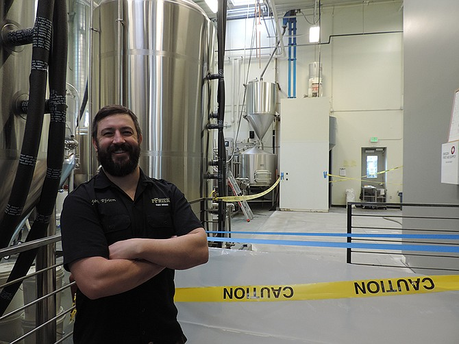 BREWMASTER, and guy with his name on the business, Josh Pfriem stands in front of the nexus of original brewing area and the new section, now under construction. The brewery, founded in 2012, is going through one of two staged expansion periods. Expansion will allow pFriem to offer an expanded range of sour beers, including Lambic, a traditional Belgian ale produced via spontaneous fermentation.