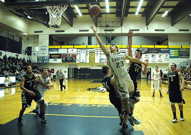 Noah Noteboom drives through two Pendleton players in a tense fourth-quarter of Friday night's thriller between the Eagles and the Buckaroos.