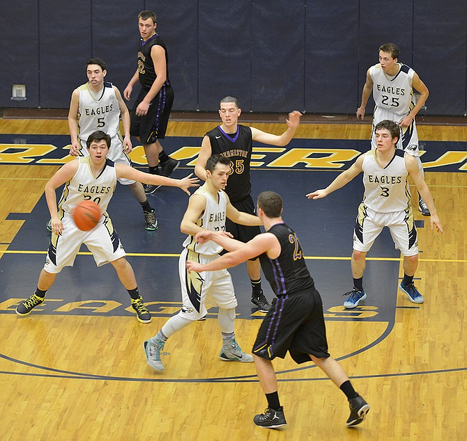 Solid defense contributed to the Eagles' 58-48 win Tuesday over Hermistion. Pictured above are (from left) Dallas Buckley, Andrew Roberts, Skyler Hunter, Austin Clark and Tyrone Stintzi holding-down the defensive end.
