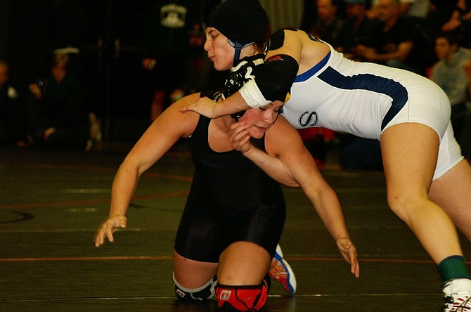 Regina Bell recently wrestled Skyview's Natasha Williams at sub-regionals and will now be headed to the WIAA Mat Classic in Tacoma.