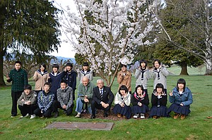 Mayor Masamitsu Aikawa and the Tsuruta group pays respects at the grave of Sister City co-founder Eiko Tadakuma's gravesite at Pine Grove Cemetery. Eiko hosted many students from Japan early on in the program and was a mother figure to the Japanese students while they were in Hood River. She also served on the board for many years.