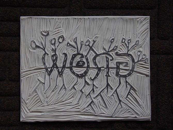 """GROW,"" one of four panels in a woodblock piece created by Klahre House students."