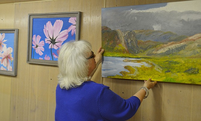 Last night (Wednesday) volunteers put in place the first installment for an art show to be held at the Sunnyside Museum this spring and summer. Pictured is Kathleen Rogers of the Sunnyside Arts Commission reviewing placement of an oil painting by Leona Bushman, formerly of Sunnyside. A reception for the public to meet and greet the artists will be held Friday, April 17, from 6 to 8 p.m. at the museum. An open house for the museum and art show is set for Saturday, April 18, from 11 a.m. to 4 p.m. Other artists set to show their work include Consuelo Soto Murphy, Rogers, Kathleen Williams, Phyllis Morrow, Kurtis Sparrow, Barbara Merz, Reva Smith, Dawn Haak and Leroy Ganser.