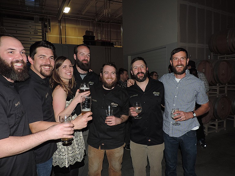 """THE BREW crew from pFriem Family Brewing toasts the release of the brewery's first bottles, April 2 in the """"sour room"""" at the expanding brewery. From left are Simon Trager, Gavin Lord, Dave McGinley, Annie Pfriem, Dan Peterson, Josh Pfriem, and Sean Grover."""