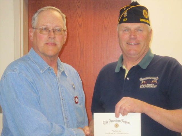 American Legion Post 37 Commander John Warford presents the Legionnaire of the Year award to Jerry Scholten.