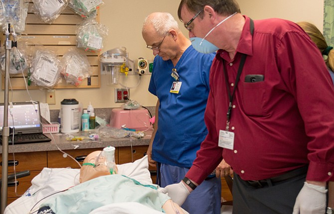 MID-COLUMBIAMedical Center emergency department staff did hands-on training with a mannequin recently to practice quickly recognizing and treating sepsis, a potentially deadly infection. In foreground is David Stone, director of emergency services and in back is Marc Eldridge, a respiratory technician II.   Contributed photo