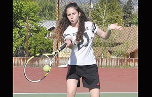 THE DALLES tennis player Marisa Cianci, of Italy, slams a return shot during her No. 1 singles match played Thursday in The Dalles.