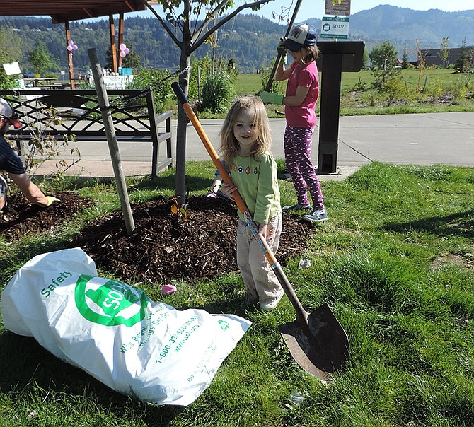 RILEY Davis, 2, of Hood River, joins her sisters, Ella, 8, and Kennedy, 6, and parents Jeremy and Kim in Saturday's Waterfront Park cleanup. More of the same is planned throughout the Hood River Waterfront (details on page A10) as part of Earth Week events.