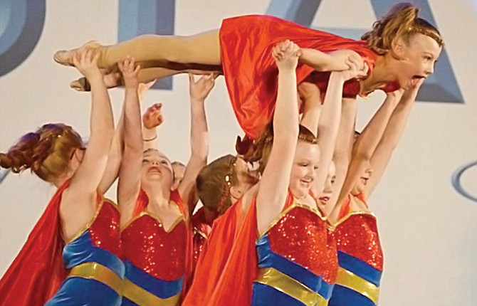 THE DALLES DANCE team members (pictured from left to right), Jayden Hansen, Ella Anderson, Mackenzie Barrett, Rylee Camp, Sophia Pullen and Tygh Timinsky (in the air) perform in the prep division of this past weekend's Onstage New York at the Portland Convention Center. This group, along with Sophia Bucher, Ava Malcolm, Jayden Hansen and Bridget Donnell received a gold medal in tap and a high silver in the jazz classification, and also added a judges' choice award for their efforts in the three-day event.
