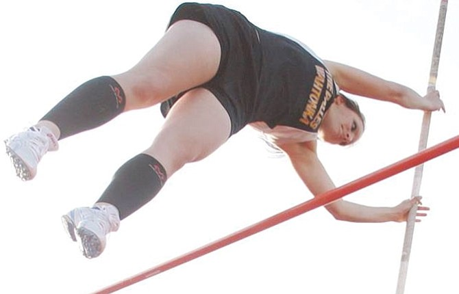 THE DALLES track and field athlete Kellina Coy soars over the line in her pole vault try earlier this season in The Dalles. Friday at the CRC Last Chance Meet in Pendleton, Coy finished in a tie for third place with a final height 7-feet-6 inches. All told, TD had 37 personal records set.